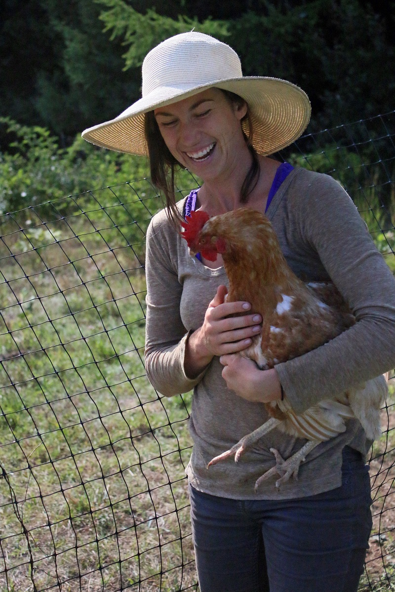Charlotte with one of the ladies who lay the eggs - Copy