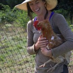 Farmer Charlotte with one of her hens