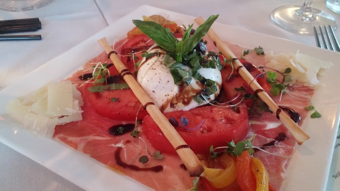 Tomatoes with Buratta and truffle oil at TerraSole