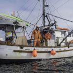 Linda Behnken ready to fish on her boat Woodstock