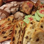 German, Irish and American style fruitcakes on a Christmas platter