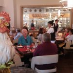 A rooster oversees the dining room at Bocuse