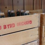 Red Byrd apple crate filled with cider