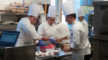 The pastry class working on dessert