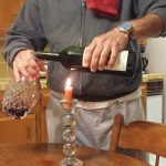 Decanting over a candle to see the sediment