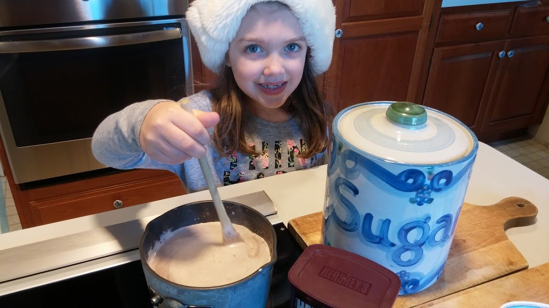 Moira stirs the hot chocolate