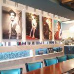 English and Italian portraits overlooking the bar