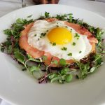 A potato pancake topped with house smoked salmon and a sunny side up egg from the Royal Wedding Viewing menu