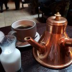 9. The coffee comes in a fancy copper pot
