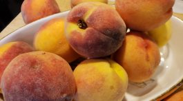 1. Ripe local peaches