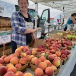 Erica Teveris of Woodland Farm with her pristine peaches
